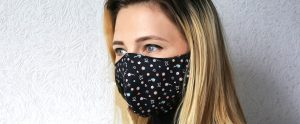 Woman wearing fabric customisable face mask